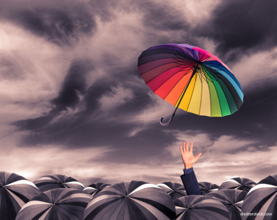 rainbow-umbrella-fly-out-from-the-business-man-hand-amoung-the-mass-of-black-umbrellas